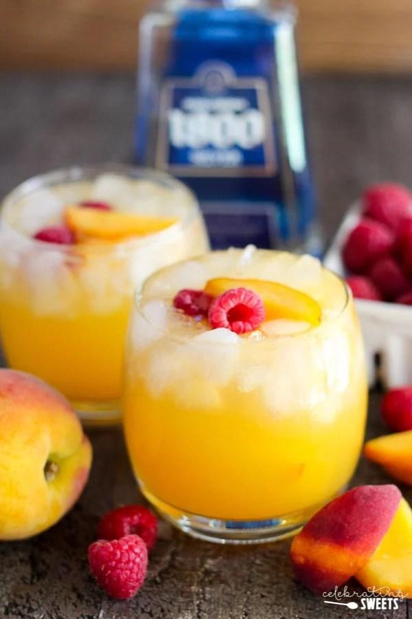 Peach Margaritas - A refreshing margarita flavored with homemade peach syrup, fresh orange juice and peaches.
