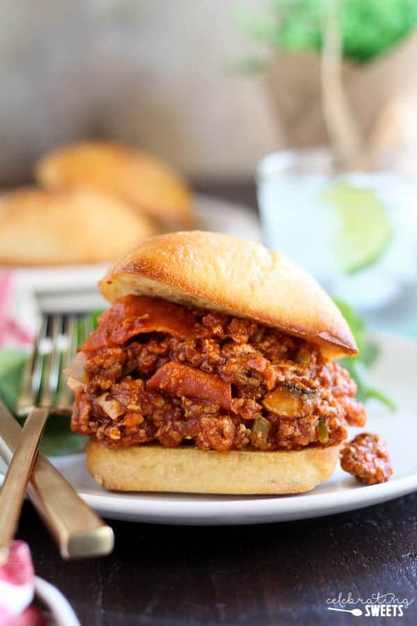 Pizza Sloppy Joes - Sloppy Joes filled with your favorite pizza toppings (think: pepperoni, sausage, mushrooms, peppers, cheese and more!) all piled high on a garlic bread roll.