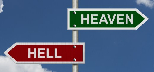 Red and green street signs with blue sky with words Heaven and Hell, Heaven versus Hell