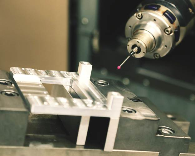 An upclose image of a CNC milling machine taking measurement prior to cutting