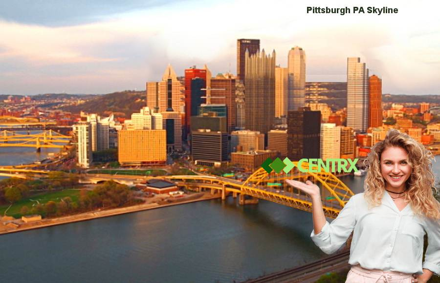 An image of the Pittsburgh Skyline on a sunny day showing the 3 rivers, not a cloud in the sky with a very attractive woman with long blonde hair holding her hand out with the centrx logo directly above.