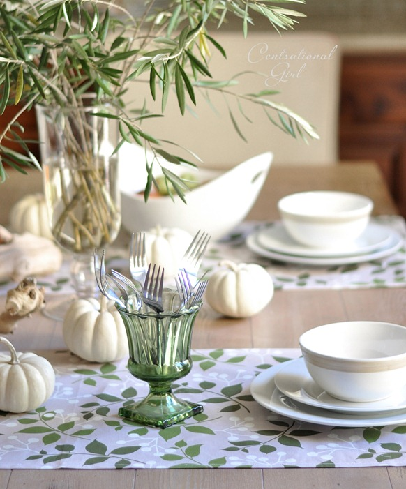green glass urn and white place settings