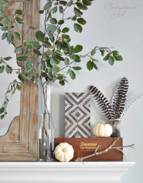 leaves pumpkins boxes on mantel