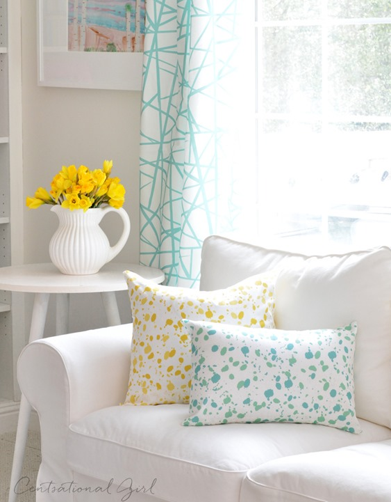 white sofa splatter pillows