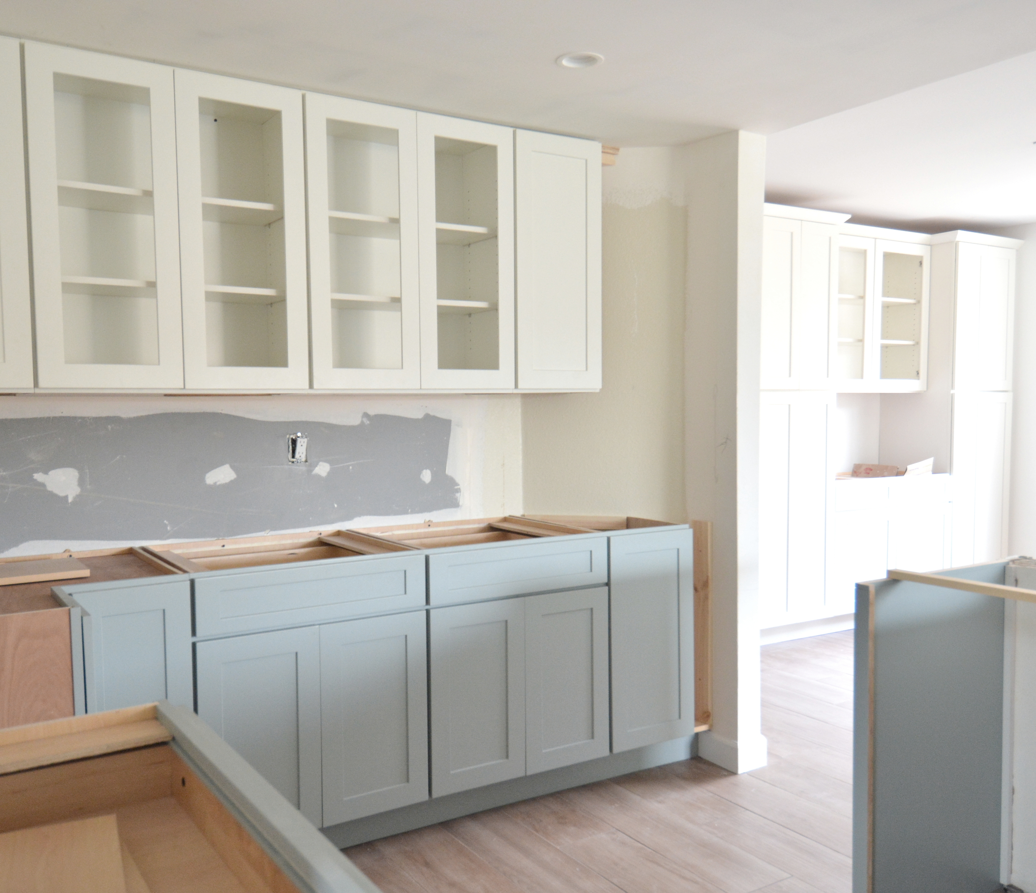 example by working with semi custom cabinets in fixed widths once they were installed i was left with a wider open space on the right of the cabinets