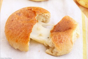 Cheese filled three cheese dinner rolls