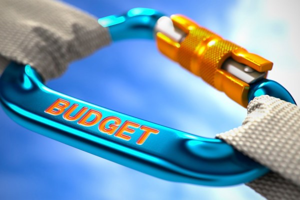 Strong Connection between Blue Carabiner and Two White Ropes Symbolizing the Budget. Selective Focus.