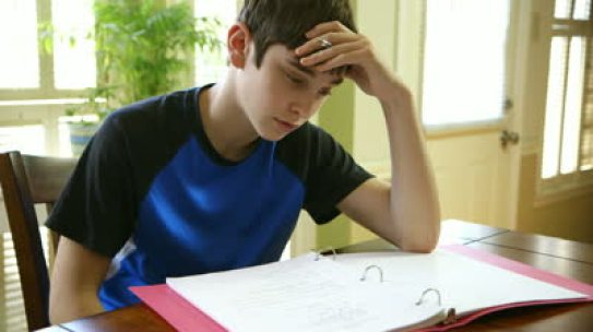stock-footage-a-teenage-boy-struggling-with-his-homework