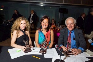 Judges Nycci Nellis of TheListAreYouOnIt.com, Philippa Hughes of the Pink Line Project, and former Washington Post columnist Bob Levey prep to present the awards of the Tango with the Stars gala on April 10th. (Photo by Kate Warren)