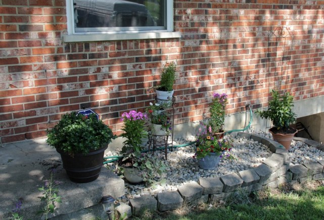 flower bed turned rock garden