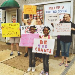 Local gun control advocates, Heeding God's Call, protest outside Miller's Sporting Goods gun shop in Linwood where they say the straw-purchasing of weapons has taken place.