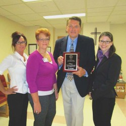 The healthcare team of the Advanced Wound Care Center at Mercy Fitzgerald Hospital, including (from left) Front Desk Coordinator Dana Zaffri, Program Coordinator Crystal Manns, RN BSN; Medical Director Dr. William Urbas and Wound Center Physician Dr. Michelle Oliver, are pictured with the Wound Center of Excellence award.