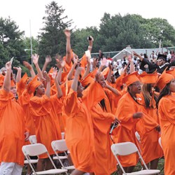 Chester High School students cheer after the announcement is made that they are official graduates.