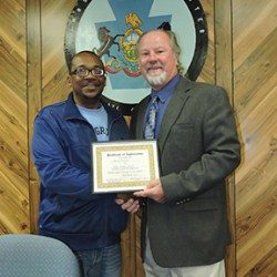 """Council Chairman Robert May, Jr. accepts a certificate on behalf of Council from Robert """"Ponch"""" Fitzgerald. Council was recognized for their support of township programs."""