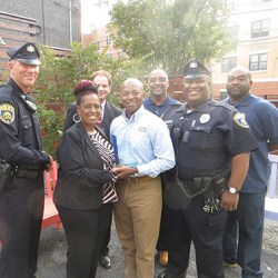 CHA Board Chair Sheila Church shares the award for Most Improved Housing Authority with CHA Housing Program Manager Douglas E. Daniel. Also pictured are maintenance and security team members (from left) John Zebley, Nate Pope, Elijah Thompson and Wilbert Jarrett. CHA Executive Director Steven A. Fischer is in back.