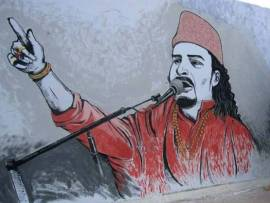 A mural in tribute to the qawwal by S M Raza and Aqib Faiz, on a wall in Korangi. Photo: S. M. Raza/Facebook