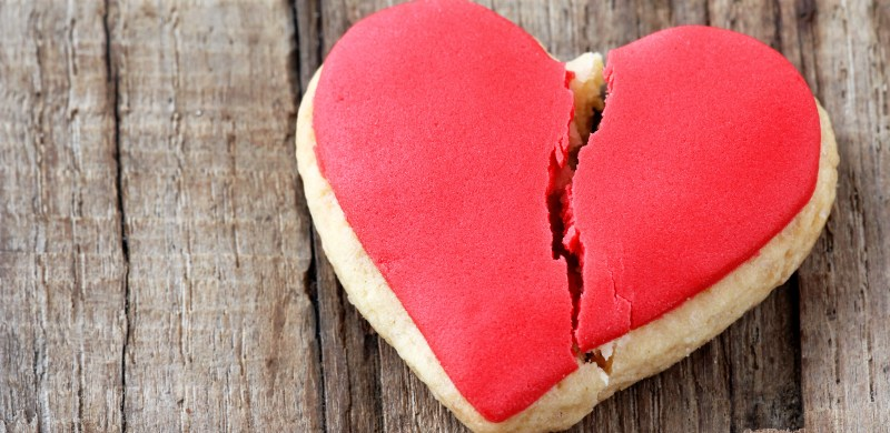 Cracked cookie as a concept of broken heart and breakup