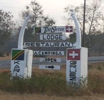 Tan-Swiss Lodge Road Sign