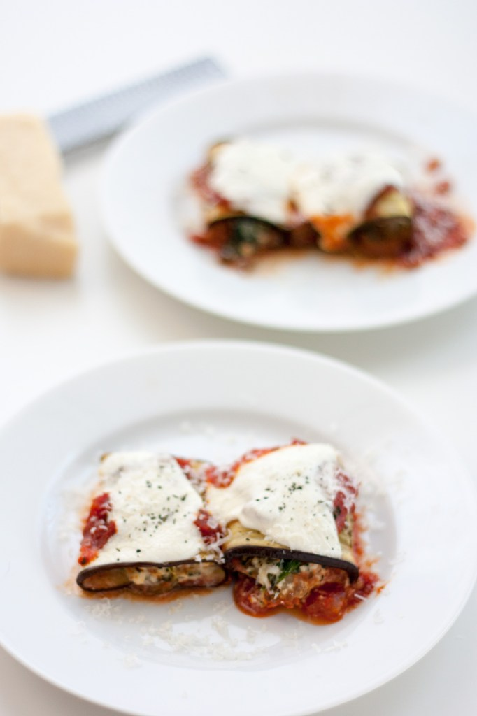 Eggplant Rollatini with Sausage and Ricotta filling - This healthy version cuts out the breading and uses low fat cheeses while still being loaded with flavor and cheese!