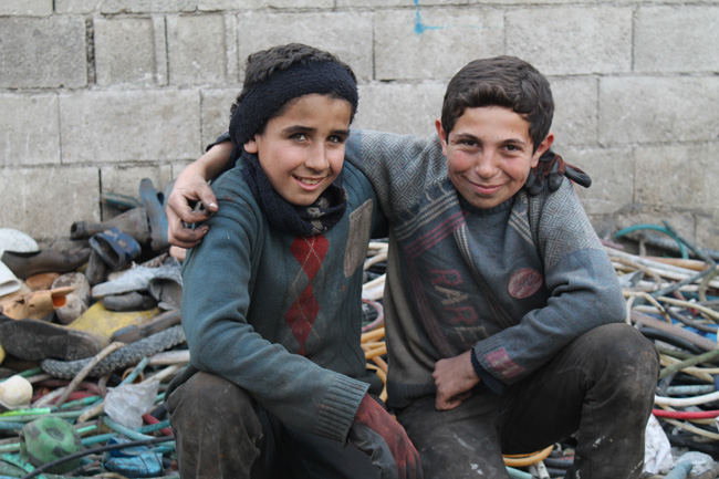 Ahmed (left) and Mahmoud, both from Aleppo, work in a dump in Turkey to provide for themselves and their families.  © UNICEF/Turkey-2014/Jansen