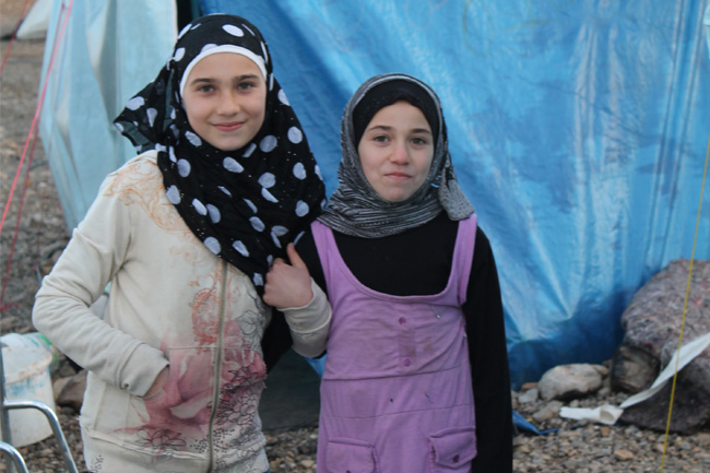 Rand (left) and her sister live in the Islahiye refugee camp in Turkey.  The 8-year old wants to become a doctor so she can return to Syria to help people who were injured in the fighting.
