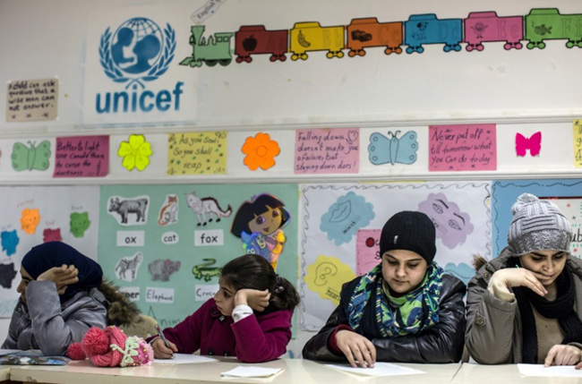 Huda sits second from right in a class at the East Amman Charity Centre. ©UNICEF/Jordan2014/Athanasiadis