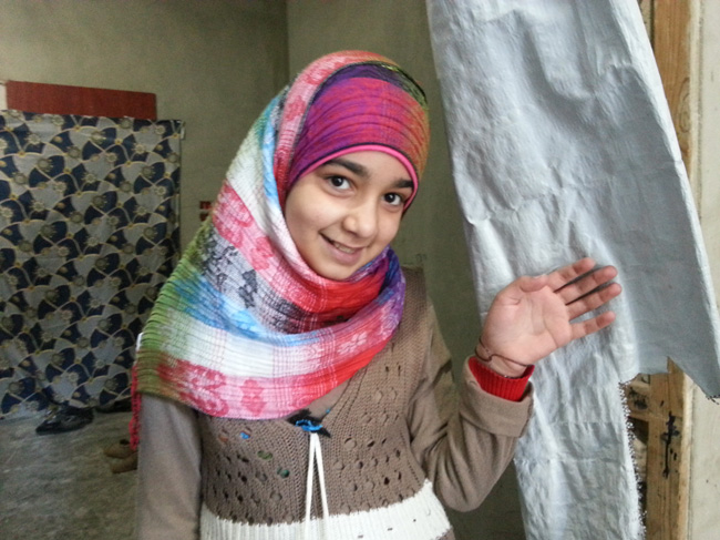 10-year old Aya and her family were displaced from their home in Homs city. They now live at a UNICEF-supported shelter in another part of the city. © UNICEF/Syria-2013/David
