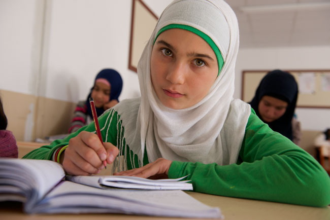 13-year old Rand attends classes in a refugee camp in Islahiye, Turkey. She and her family fled the fighting Idlib, Syria eight months ago.                                       © UNICEF/Turkey-2014/Noorani