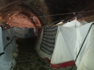 Tents in basement Old City shelter