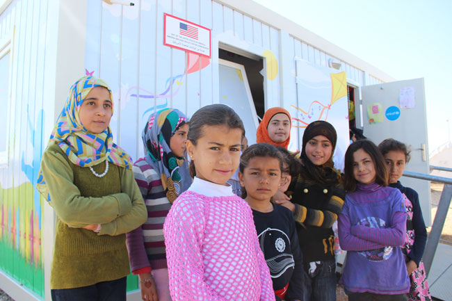 Razan and her friends stand outside UNICEF's child-friendly space at the Sarıçam refugee camp in Adana, Turkey.  ©UNICEF/Turkey-2014/Yurtsever