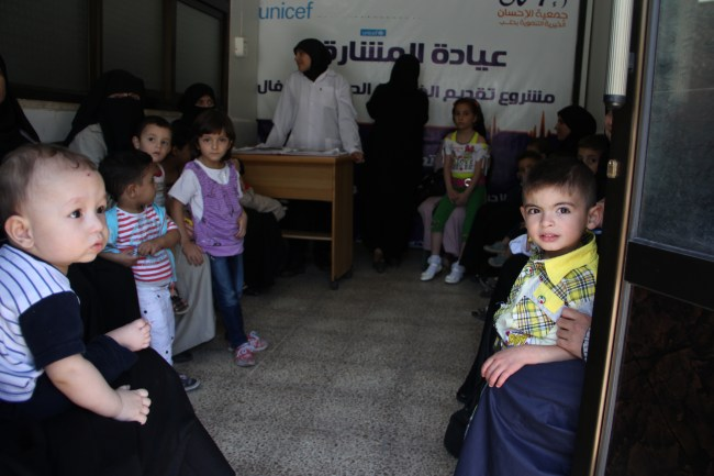 Mothers with their children in the waiting room of a UNICEF-supported health clinic in Aleppo city. There is a spike in water-borne diseases with children under 5 particularly at risk. ©UNICEF/Syria-2014/Rashidi