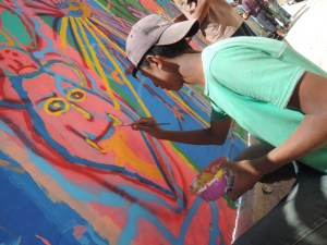 ©UNICEF/ Jordan-2014/ Fricker 16 year old Mohammad provides his creative touch to the mural