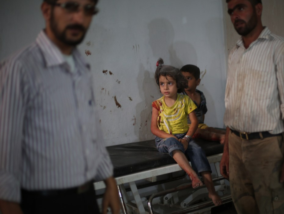 Two children waiting  along with their father to receive medical care at a field hospital in East Ghouta following an airstrike on their neighborhood. ©UNICEF/2015/Syria/Mohammad Badra
