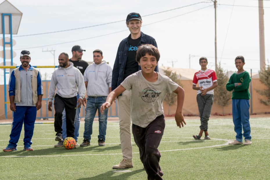 UNICEF Goodwill Ambassador Liam Neeson plays football during a visit to a Makani centre in Za'atari refugee camp in Jordan on Nov 7, 2016. UNICEF/Jordan/2016/Herwig