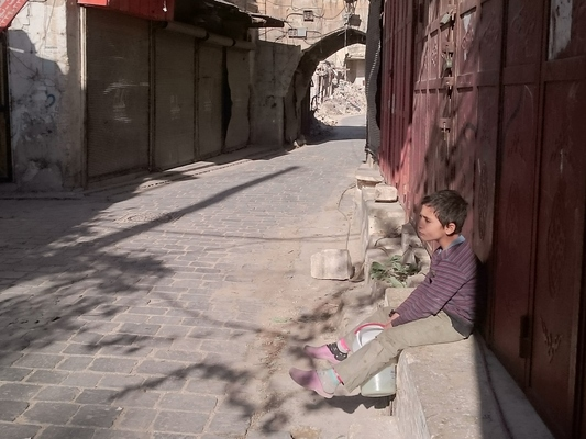 "On 20 November 2016, Abdullah, 9, sitting in one of the neighbourhoods in the old city of Aleppo holding his jerry can. ""I'm looking for drinking water since early in the morning because we don't have water at home. The water comes and goes, it goes off for a long time at home,"" Abdullah says. In October 2016, the overall humanitarian situation in the country has deteriorated. Violence intensified in Aleppo city, Idleb and Rural Damascus, resulting in child casualties and extensive damage to civilian infrastructure. Grave child rights violations including killing and maiming of children, attacks on schools and hospitals, sexual violence, abduction and recruitment and use of children, particularly in Aleppo, Rural Damascus and Al-Hasakeh Governorates, were documented by the UN.  Ongoing military operations and clashes with armed opposition groups intensified in Aleppo, Rural Damascus, Rural Homs, Hama and Deir-ez-Zor hampering the delivery of humanitarian assistance to the hard to reach (HTR) and besieged areas in these locations. The limited humanitarian access coupled with the restrictions on free movement of civilians, including children, have impacted the access of populations to essential basic commodities such as food, clean water, health care and education. In Eastern Aleppo, access for the delivery of humanitarian supplies has been denied by parties to the conflict. Delivery of vaccines for immunization of children under five (U5) has not been feasible since July 2016 due to the ongoing hostilities, placing children at high risk of communicable diseases. In addition, over 80,000 children in Eastern Aleppo (aged 3-18 years old) are at risk of death or injury and in desperate need of psychosocial support. In Western Aleppo, an estimated 1.2 million people do not have access to clean water due to the damage to the water pumping station supplying the city. Meanwhile, in Eastern Aleppo, the Bab al Nayrab pumping station has been functioning since 9 Octo"
