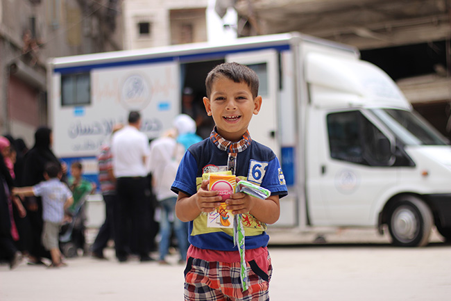 © UNICEF Syrian Arab Republic/2017/Al-Issa A young boy who received medicine after being examined by a mobile health clinic in the eastern neighbourhoods of Aleppo city. After years of violence and destruction, there are no functioning public health centres in the area, and most families rely on these mobile clinics for healthcare services.