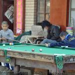 Kid playing snooker