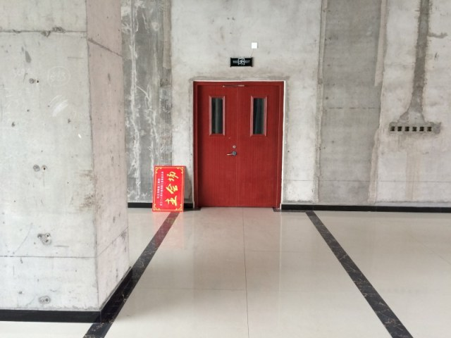 A door is seen at an empty area inside of Hongxiang Building, which houses an incubator for high-tech start-ups, in Shacheng, Hebei Province, China, May 11, 2016. REUTERS/Sue-Lin Wong