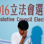 Eddie Chu Hoi-dick, weeps after winning a seat in the Legislative Council election, in Hong Kong, China September 5, 2016. REUTERS/Tyrone Siu
