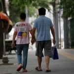 Wang and her husband Liu hold hands as they walk toward a hospital in Beijing, China, June 23, 2016. REUTERS/Kim Kyung-Hoon