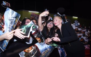 Tilda Swinton with fans (wearing Evening suit Black with gold face: Schiapparelli haute couture)