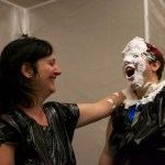 Mistress Messiér delivers the first pie of the afternoon to Maya Kralovna at the Debauchery 2013 messyplay demo.