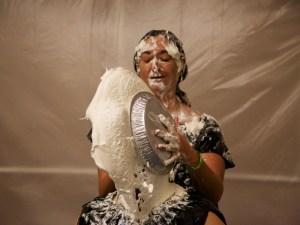 Mistress Messiér demonstrates the art of the pie sandwich on Maya Kralovna at the Debauchery 2012 messyplay demo.