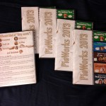 "Five DVD cases displaying the ""PieWorks 2013"" cover art."