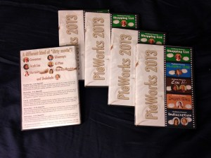 """Five DVD cases displaying the """"PieWorks 2013"""" cover art."""