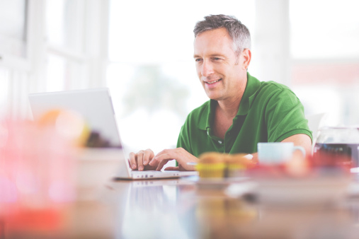 Middle-Aged Man Using a Laptop