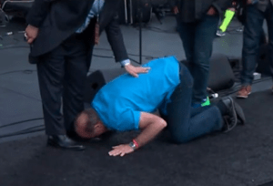 Lou Engle kissing the feet of a Pope Benedict appointee. (screenshot courtesy Herescope)