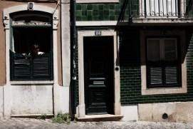 Lisbon street woman in window