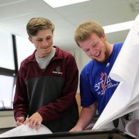 Students work to finish industrial arts projects.