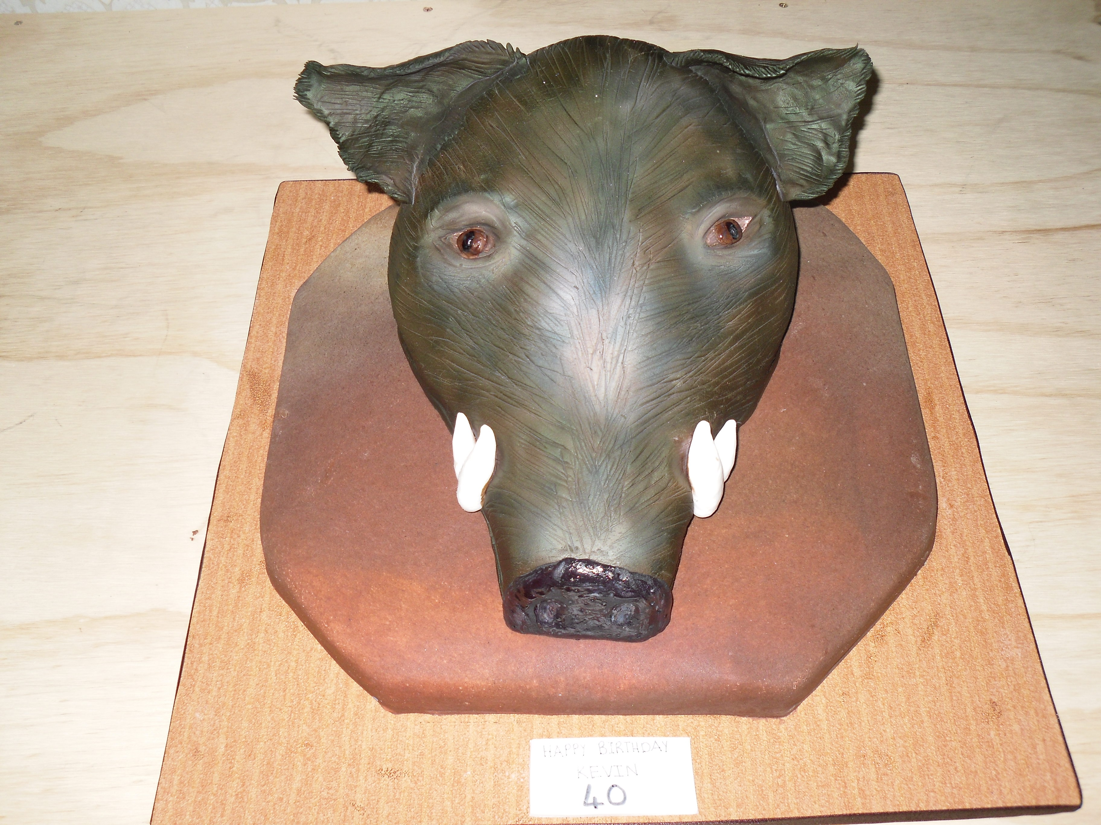 A cake in the shape of a boars head